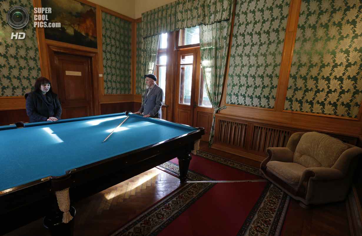 Visitors visit billiard room of Soviet dictator Joseph Stalinís Villa in Sochi