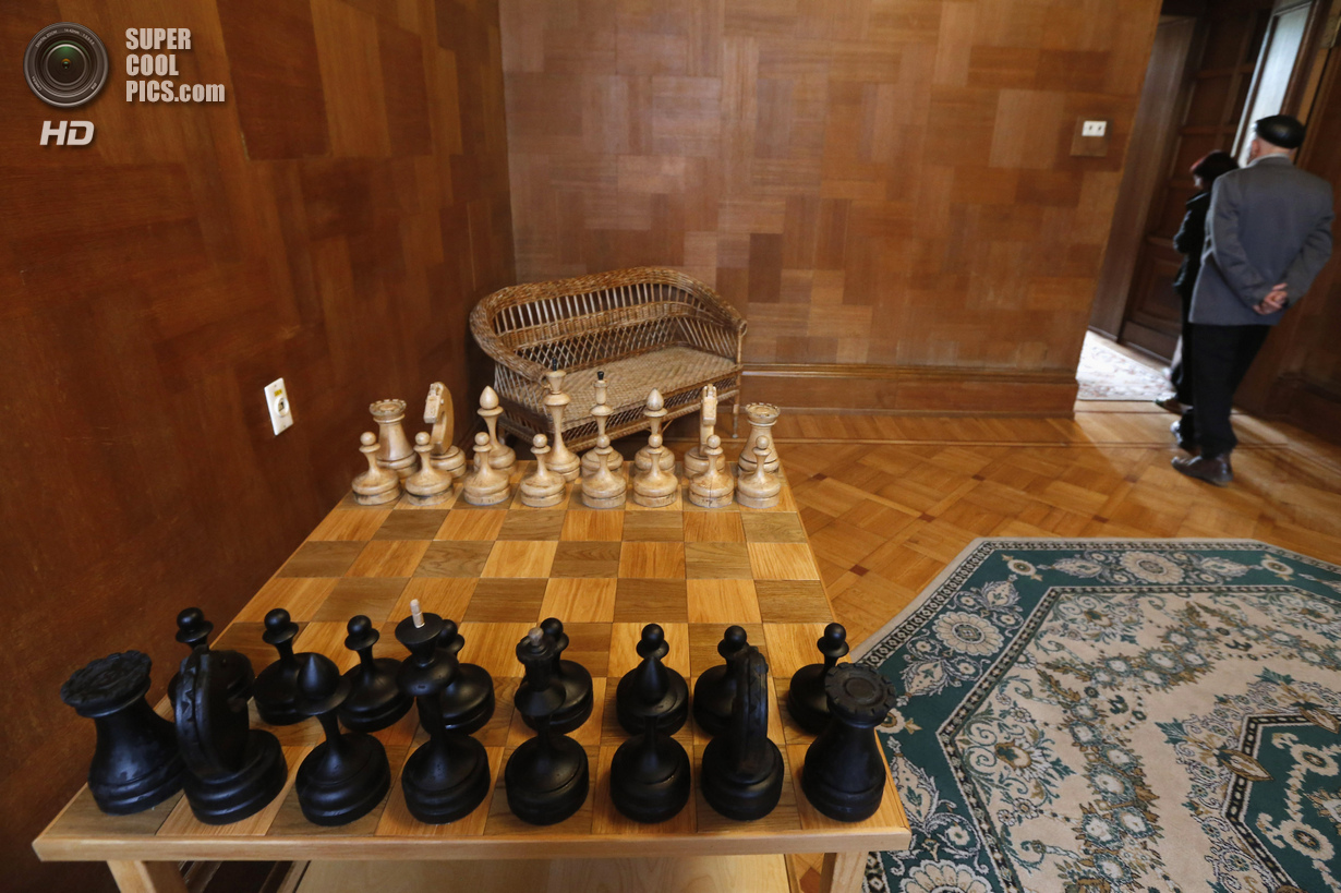 People leave room that houses Soviet dictator Joseph Stalin's chess set at Stalinís Villa in Sochi